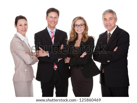 Smiling group of stylish business professionals standing in a row with their arms folded looking at the camera isolated on white - stock photo