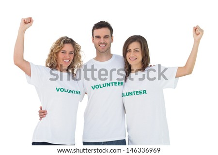 Smiling group of volunteers raising arms on white background - stock photo