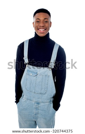 Smiling guy posing in fashionable outfit