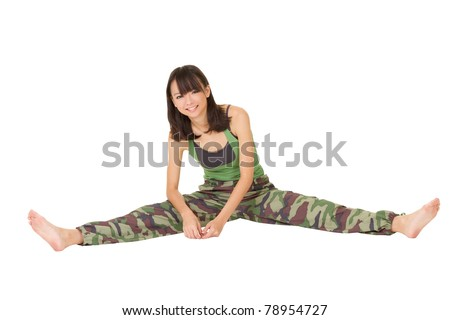 Smiling gym woman doing stretch excise on ground, full length portrait isolated on white background.