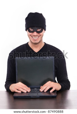 smiling hacker stealing data - stock photo