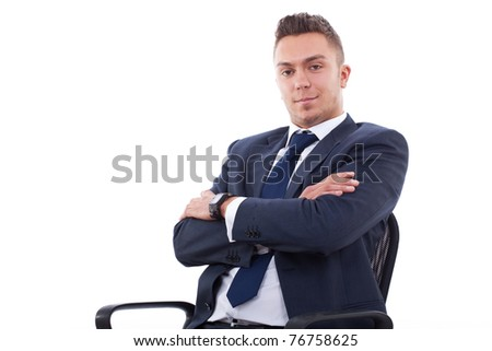 Smiling, handsome business man. Seating on chair. Looking at camera. White background