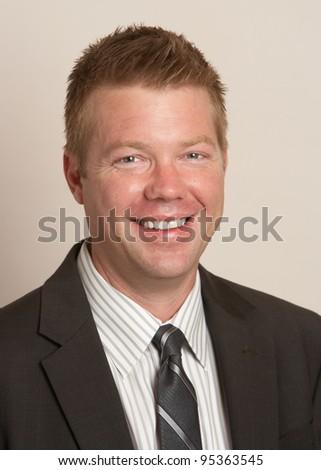 Smiling handsome businessman happy portrait man - stock photo