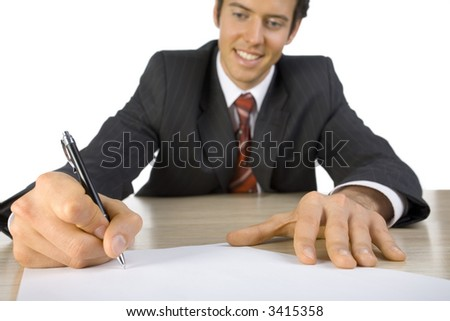 Smiling, handsome businessman. Seating behind desk, writing something. Closeup on hands. White background, front