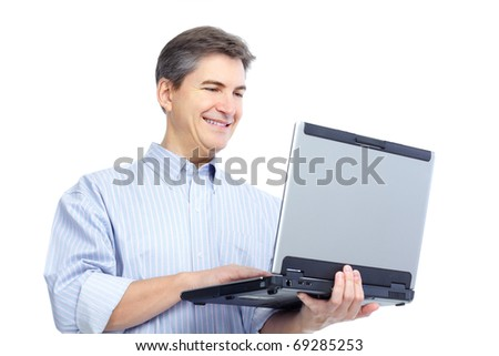Smiling handsome businessman working with laptop. Isolated over white background - stock photo
