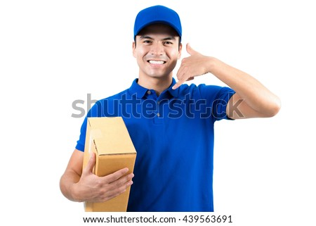 Smiling handsome delivery man holding box and making call me gesture - isolated on white background - stock photo
