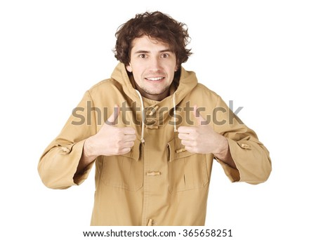 Smiling handsome man in light brown vintage raincoat. - stock photo
