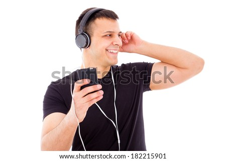 smiling handsome man looking aside with headphones and music player