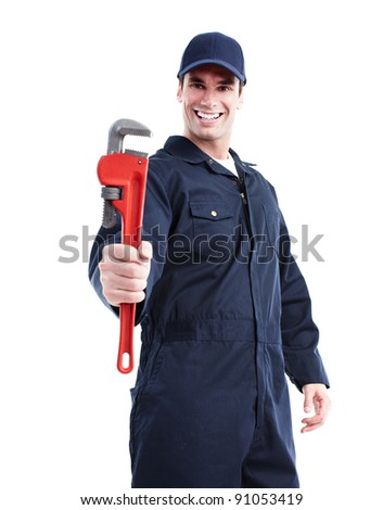 Smiling handsome plumber with an adjustable wrench. - stock photo