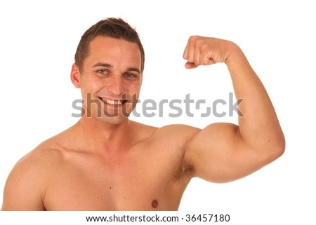 Smiling handsome young bodybuilder showing his biceps