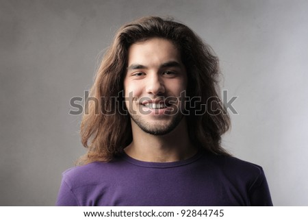 Smiling handsome young man - stock photo