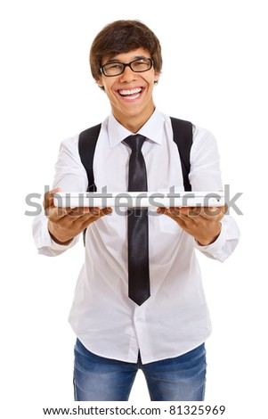 Smiling handsome young man in glasses with back pack and laptop over isolated background. Mask included - stock photo