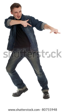 smiling handsome young man pointing in side - stock photo