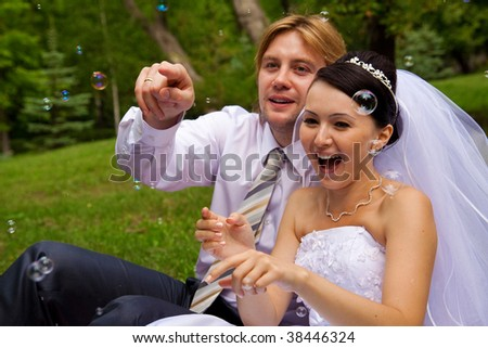 smiling happiness newlywed with soap bubbles