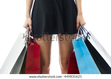 Smiling happy Asian woman shopping and holding bags
