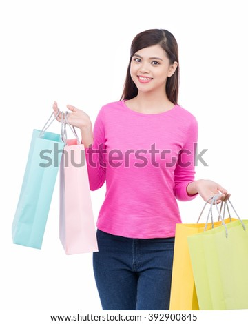 Smiling happy Asian woman shopping and holding bags isolated on white background. - stock photo