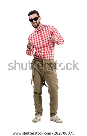 Smiling happy bearded hipster pointing towards camera with index finger.  Full body length portrait isolated over white background.  - stock photo