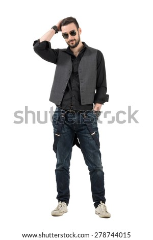 Smiling happy bearded man adjusting hair looking at camera. Full body length portrait isolated over white background.