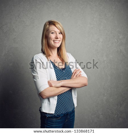 Smiling happy beautiful confident young woman - stock photo