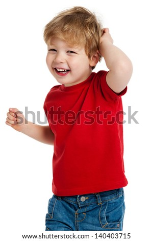 Smiling happy boy in red T shirt shot in the studio on a white background. - stock photo
