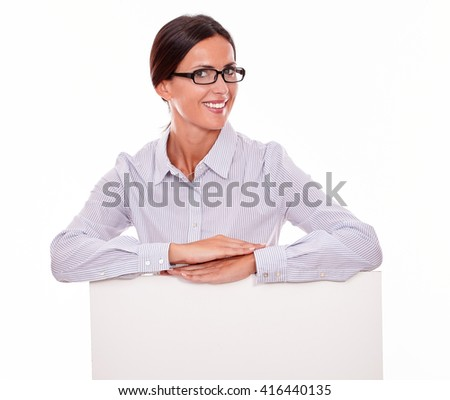 Smiling happy brunette businesswoman wearing her hair back and a button down shirt, with both hands flat on the placard, looking at the camera on a white background - stock photo