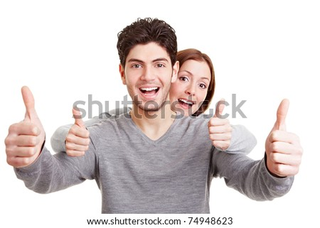 Smiling happy couple holding both thumbs up
