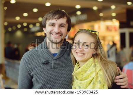 smiling happy couple in cafe