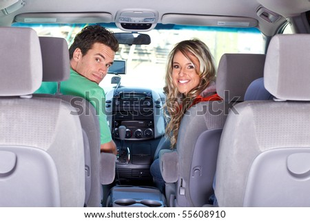 Smiling happy couple in the car - stock photo