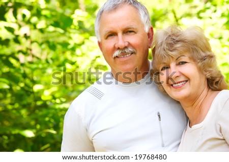 Smiling happy elderly couple in love - stock photo