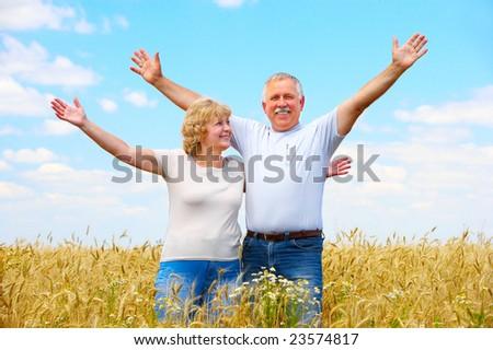 Smiling happy elderly couple in love outdoor - stock photo