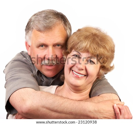 Smiling happy elderly couple in love. Over white background - stock photo