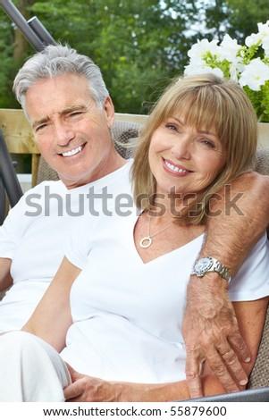 Smiling happy  elderly couple in summer park - stock photo