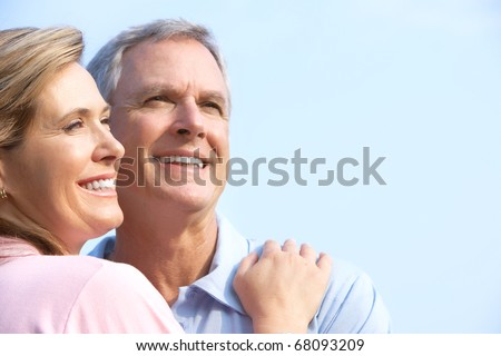 Smiling happy  elderly couple in summer park - stock photo