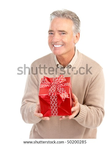 Smiling happy elderly man with a present. Isolated over white background - stock photo
