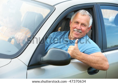 Smiling happy elderly senior  man  in the new car - stock photo