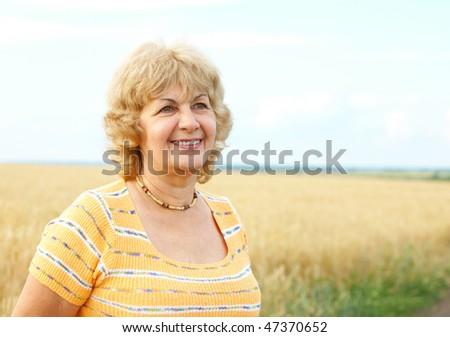 Smiling happy elderly senior  woman - stock photo