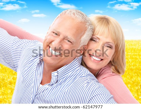 Smiling happy elderly seniors couple outdoor - stock photo