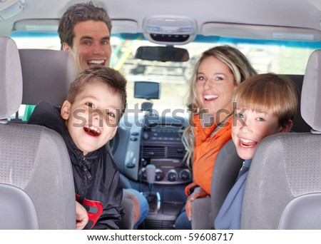 Smiling happy family and a family car - stock photo