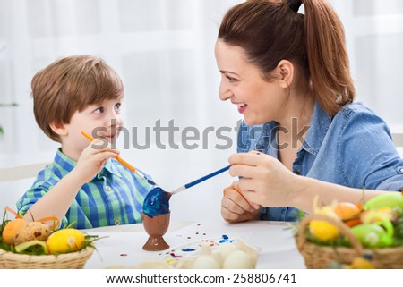 Smiling happy family enjoy at home for easter time - stock photo