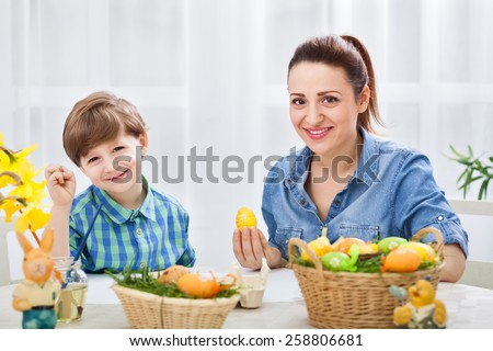 Smiling happy family in easter time - stock photo