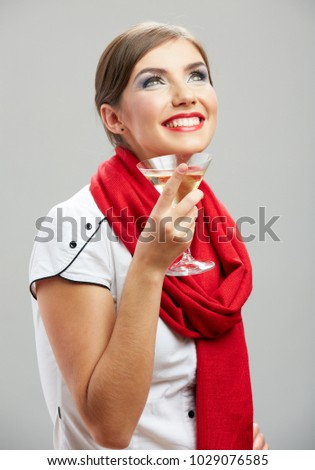 Smiling happy girl drinking alcohol cocktail. isolated studio portrait.