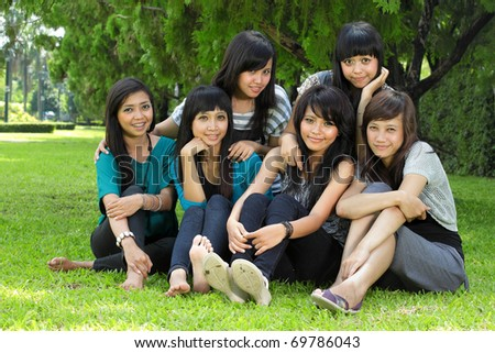 Smiling Happy girl friends group in the park - stock photo