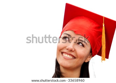 smiling happy girl on graduation day wearing gown - stock photo