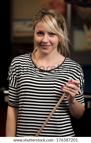 Smiling Happy Girl Playing Billiard - Portrait Of A Young Women - stock photo