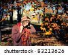 Smiling happy girl portrait, autumn outdoor. - stock photo