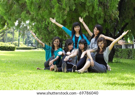 Smiling Happy group of girl friends in the park - stock photo