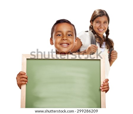 Smiling Happy Hispanic Boy and Girl Holding Blank Chalk Board Isolated on White. - stock photo