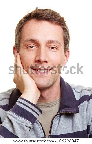 Smiling happy relaxed man with hand on chin