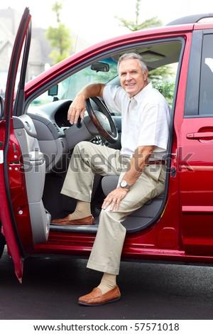 Smiling happy senior man  in the car - stock photo