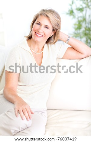 Smiling happy  senior woman relaxing at home. - stock photo